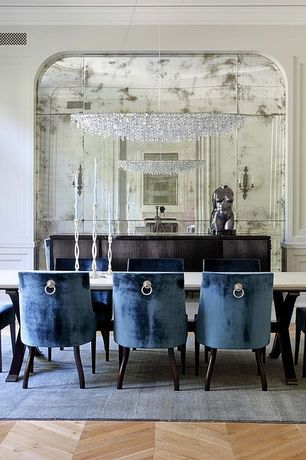 Contemporary Dining Room with Wall sconce, Crown molding, Standard height, Hardwood floors, Paint, Wainscotting, Chandelier