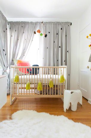 Contemporary Kids Bedroom with Spot on Square Oliv Crib, Hardwood floors, Safavieh Hand-woven Sheep Skin White Sheep Skin Rug