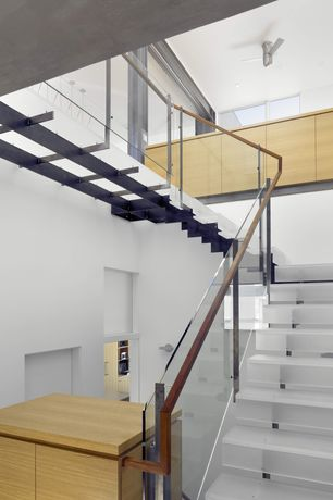 Contemporary Staircase with Ceiling fan, High ceiling, Glass staircase