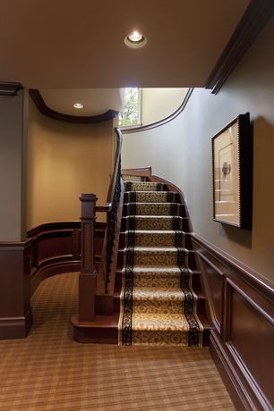 Traditional Staircase with Wainscotting, High ceiling, Hardwood floors, Crown molding