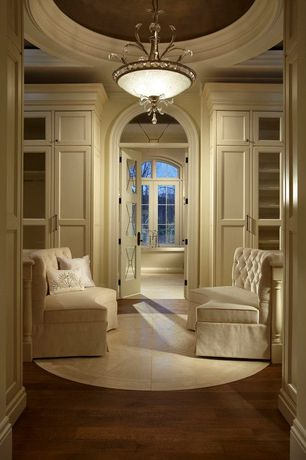 Traditional Closet with Arched window, Riemann curved tufted sectional, Close, Crown molding, Hardwood floors, Pendant light