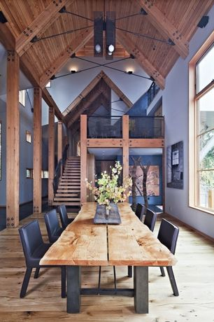 Contemporary Dining Room with Cathedral ceiling, Loft, Columns, Hardwood floors, Chandelier, Southern Yellow Pine Flooring