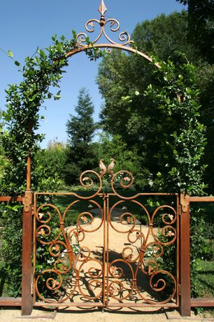 Traditional Landscape/Yard with Wrought iron railing, Arbor, Pavestone Paver Sand, Gate, exterior stone floors, Pathway