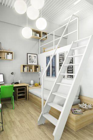 Contemporary Home Office with Pendant light, Built-in bookshelf, flat door, Solid hardwood flooring, Hardwood floors