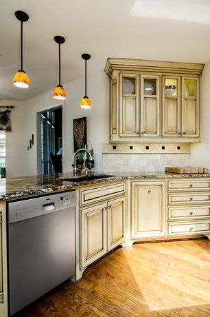 Country Kitchen with L-shaped, Undermount sink, Pendant light, Complex granite counters, Stone Tile, Limestone Tile