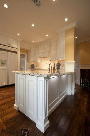 Traditional Kitchen with can lights, Subway Tile, U-shaped, Crown molding, Custom hood, electric cooktop, Flat panel cabinets