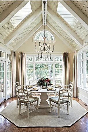 Cottage Dining Room with Arched window, Transom window, Casement, Pottery Barn Emery Linen/Cotton Drape, Chandelier, Skylight
