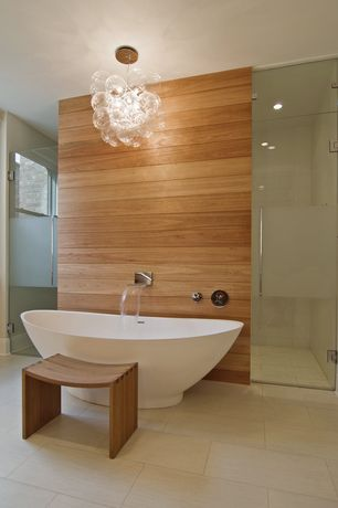 Contemporary Master Bathroom with frameless showerdoor, Waterfall tub filler - chrome finish, Chandelier, Master bathroom