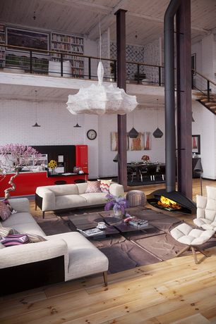 Contemporary Living Room with interior brick, Columns, Loft, Wood Stove fireplace, High ceiling, Hardwood floors, Fireplace