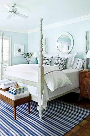 Cottage Master Bedroom with West Elm Parsons Round Mirror - Bone Inlay, Ceiling fan, terracotta tile floors, Crown molding