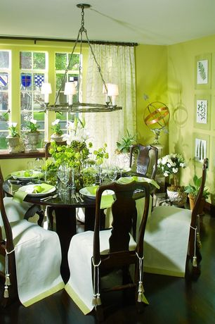 Traditional Dining Room with Hardwood floors, Casement, Chandelier, Standard height, Paint 1