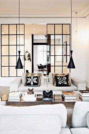 Contemporary Living Room with Design within reach - eames molded plastic dowel-leg armchair, Pendant light, Hardwood floors