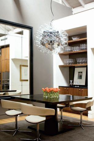 Contemporary Dining Room with Hardwood floors, Built-in bookshelf, Exposed beam, High ceiling, Chandelier