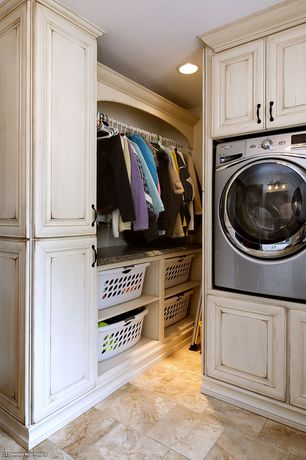 Country Laundry Room with Built-in bookshelf, Undermount sink, travertine tile floors, California Closets Custom Wardrobe