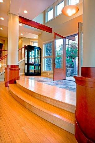 Contemporary Entryway with flush light, High ceiling, Hardwood floors, double-hung window, Casement, can lights, French doors