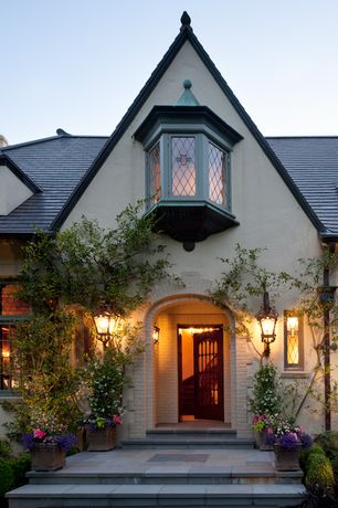 Country Front Door with exterior stone floors, Bay window, French doors, picture window, Pathway