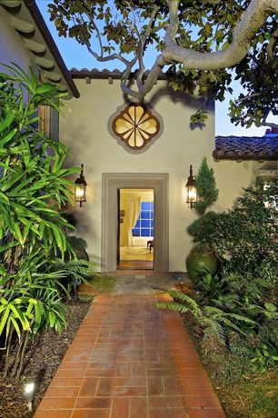 Mediterranean Front Door with exterior brick floors, specialty window, Pathway