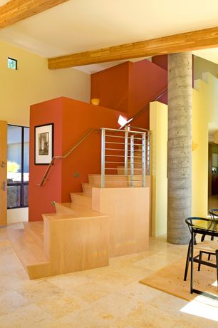 Modern Staircase with sandstone tile floors, Glass panel door, Exposed beam, Wall sconce, Columns