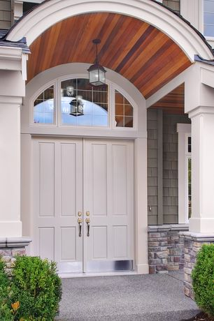 Traditional Front Door with exterior stone floors, Transom window