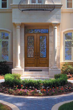 Traditional Front Door with Glass panel door, exterior concrete tile floors, Pathway, Transom window, exterior tile floors
