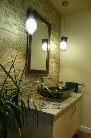 Modern Powder Room with Flush, Daltile Slate Radiance Cactus Staggered Random Mosaic, Hardwood floors, Limestone counters