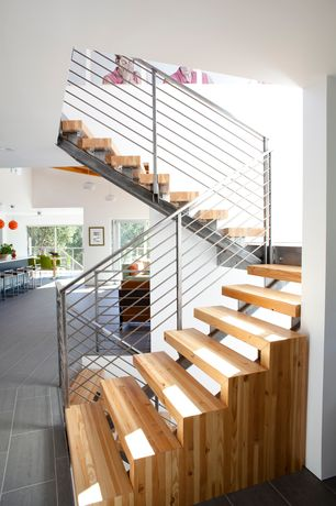 Contemporary Staircase with Spiral staircase, High ceiling, Hardwood floors