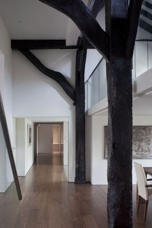 Modern Hallway with Loft, Wide plank floors, Exposed beam, Hardwood floors, Columns, High ceiling
