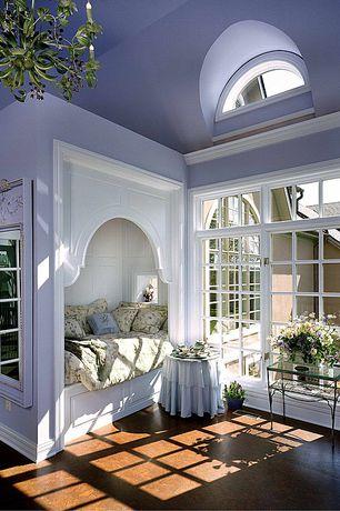 Traditional Guest Bedroom with specialty window, Concrete floors, Standard height, Chandelier, Built-in bookshelf, Casement