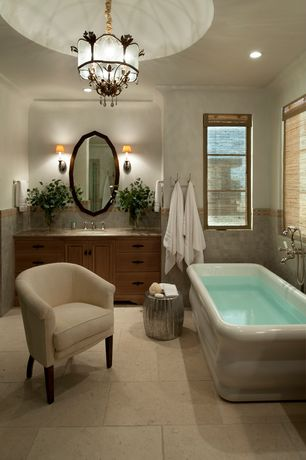 Mediterranean Master Bathroom with Raised panel, Flush, Master bathroom, European Cabinets, Limestone counters, Wall sconce