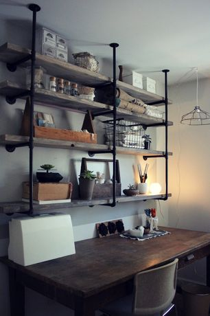 Rustic Home Office with Raw wood shelves, Sylvie liv hanging metal wire lamp, Concrete floors, Galvanized piping