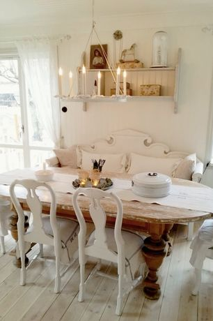Cottage Dining Room with Built-in bookshelf, Queen Anne Chairs with Arms, Hardwood floors, French doors, Chandelier