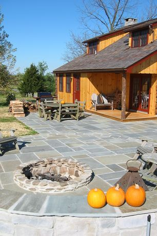 Country Patio with exterior stone floors, Outdoor kitchen, French doors, Casement, Fire pit, Pathway