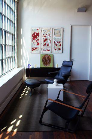Modern Living Room with flat door, Casement, High ceiling, Window seat, Hardwood floors