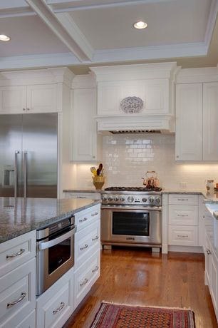 Traditional Kitchen with Flat panel cabinets, Custom hood, Standard height, Kitchen island, L-shaped, Simple granite counters