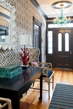 Eclectic Entryway with Chandelier, interior wallpaper, Hardwood floors, Glass panel door, Crown molding, Transom window