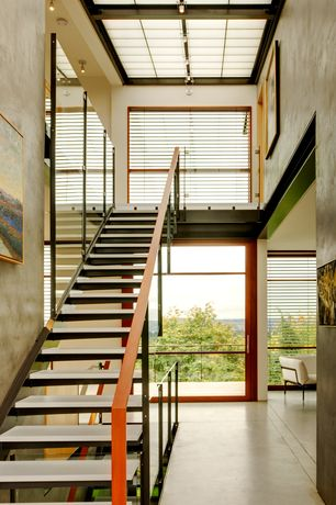 Modern Staircase with Concrete floors, Pendant light, Skylight, High ceiling, Floating staircase