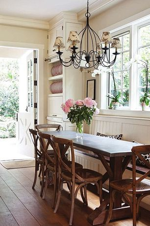 Cottage Dining Room with Paint, Hardwood floors, picture window, Standard height, Window seat, Dutch door, Built-in bookshelf