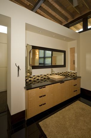 Modern Master Bathroom with Exposed beam, Soapstone counters, Inset cabinets, Ceramic Tile, European Cabinets, Vessel sink