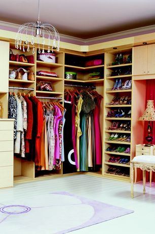 Modern Closet with Laminate floors, Chandelier, California Closets Walk-In Closet Custom Cabinetry, Crown molding, Area rug