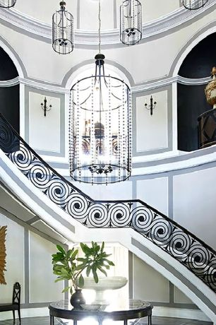 Traditional Entryway with Arched window, complex marble floors, Pendant light, Paint, Skylight, High ceiling