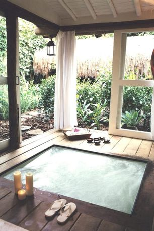 Asian Hot Tub with Exposed beam, Pendant light, Sheer curtains, Gazebo, Sunken hot tub, Painted wood panel ceiling, Pathway