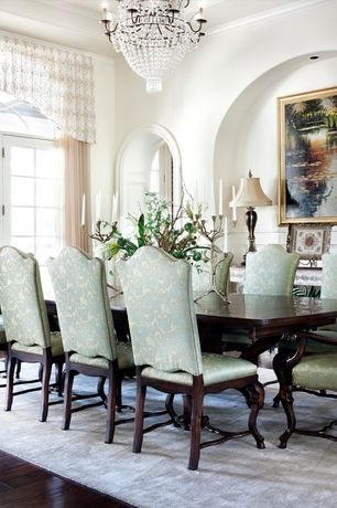 Traditional Dining Room with Chandelier, Standard height, French doors, Transom window, can lights, Crown molding