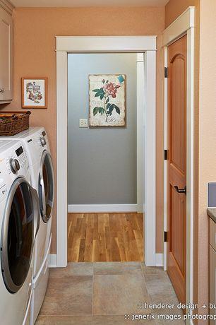 Traditional Laundry Room with Built-in bookshelf, Undermount sink, specialty door, travertine tile floors