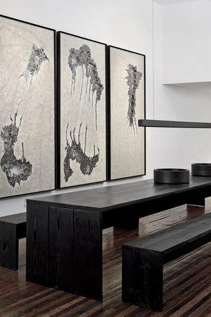 Modern Dining Room with Hardwood floors, Built-in bookshelf