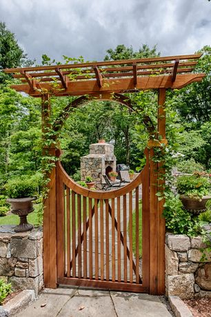 Asian Landscape/Yard with exterior stone floors, Trellis, Arbor, Fence, outdoor pizza oven, Gate, Pathway, Saloon door