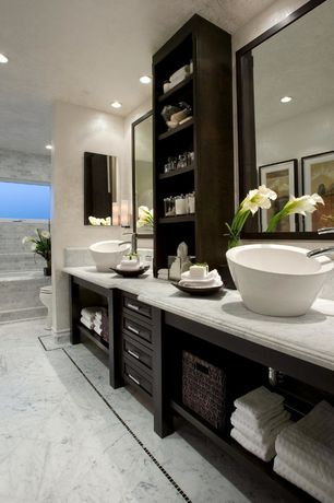 Contemporary Master Bathroom with Complex marble counters, Wall sconce, Raised panel, Master bathroom, Double sink, Flush