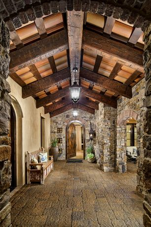 Mediterranean Entryway with picture window, High ceiling, slate floors, Faux wood beam, Paint, Arch doorway, Pendant light