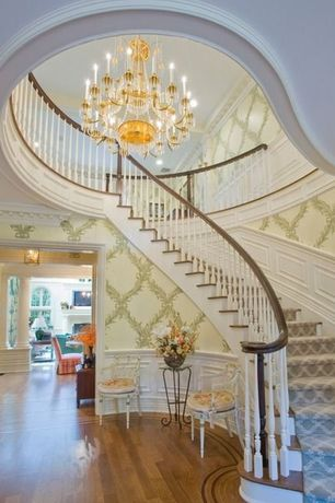 Traditional Staircase with Chandelier, Wainscotting, High ceiling, Hardwood floors, interior wallpaper