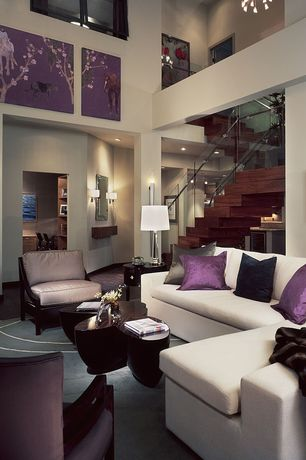 Art Deco Living Room with Wall sconce, Columns, Glass railing, Carpet, Wood stair treads, Cathedral ceiling, glass ra