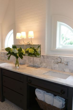 Traditional Master Bathroom with partial backsplash, Complex Marble, High ceiling, Inset cabinets, penny tile floors, Paint